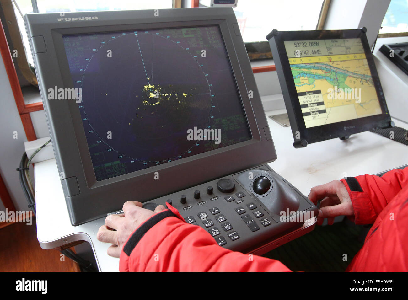 Hamburg, Germany. 8th Jan, 2016. A crew memnber is testing a radar system onboard the former research vessel 'Clupea' - Stock Image