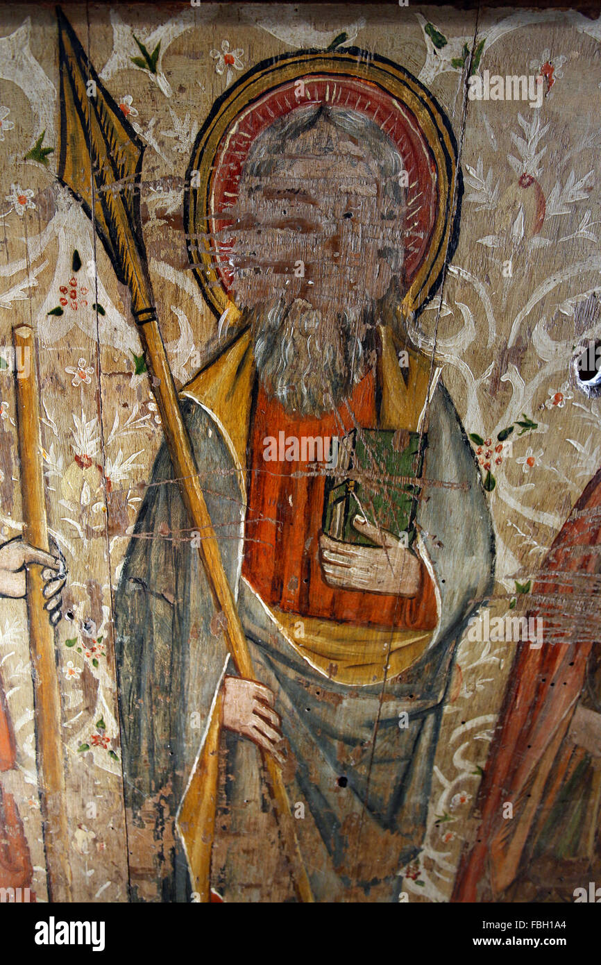 Painted Saint on the Rood Screen, St Thomas Apostle carrying a spear, and holding a bible. St Michael's Church, - Stock Image
