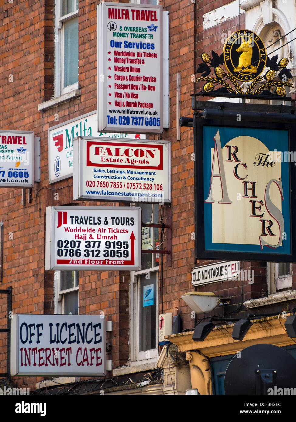 Colourful signs along Brick Lane, London - Stock Image