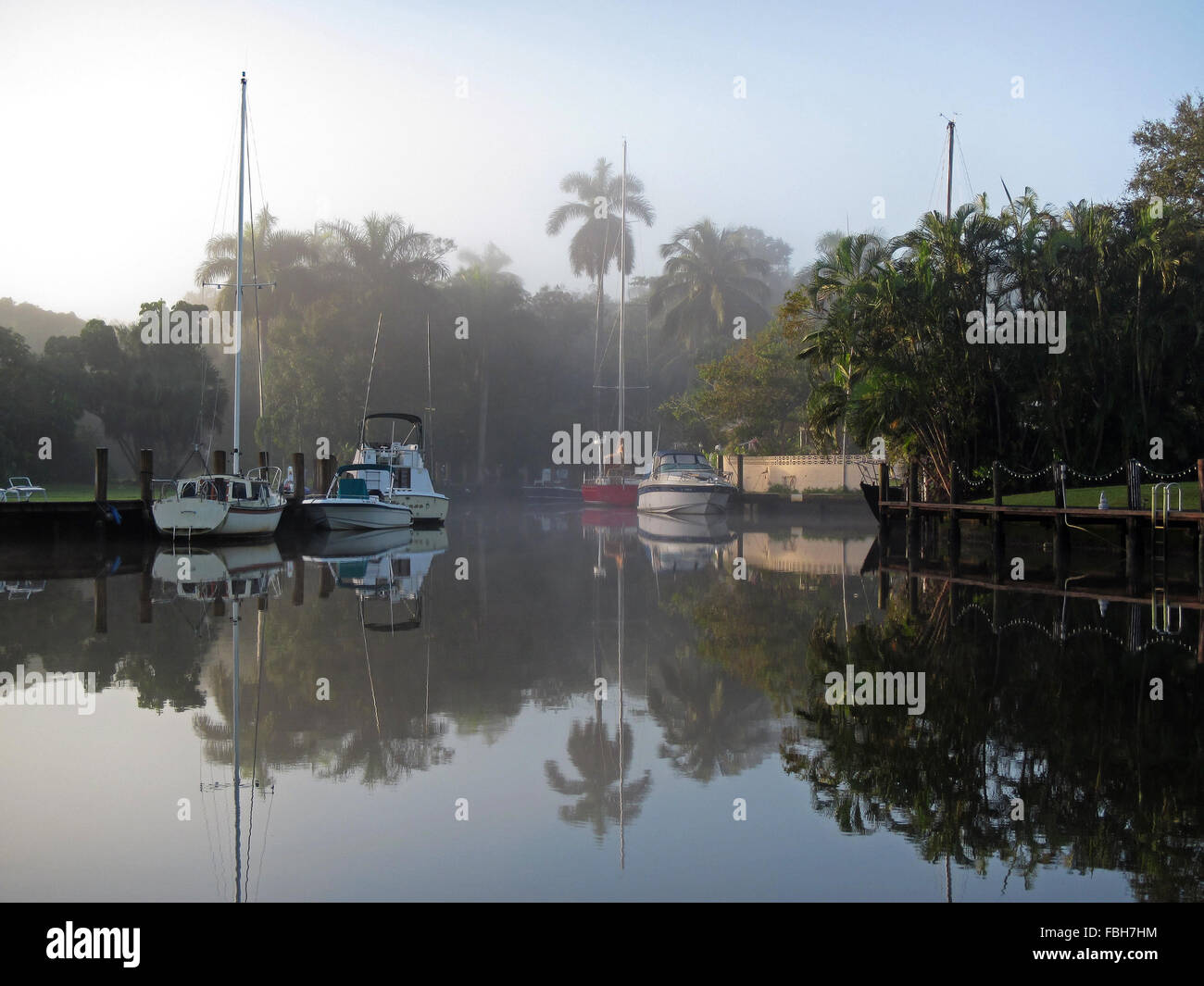 Foggy sunrise amidst yachts on New River, Fort Lauderdale, Florida Stock Photo