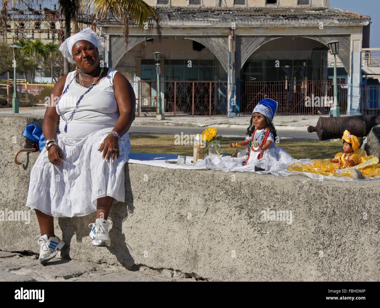 Fortune teller awaiting customers outside church in Regla, Cuba - Stock Image