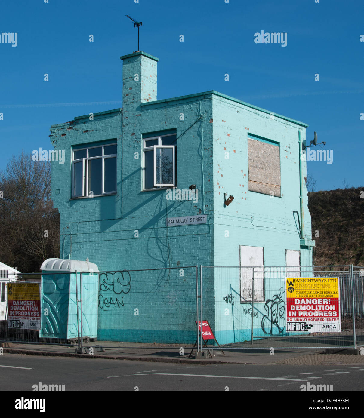 Turquoise Building Being Demolished - Stock Image