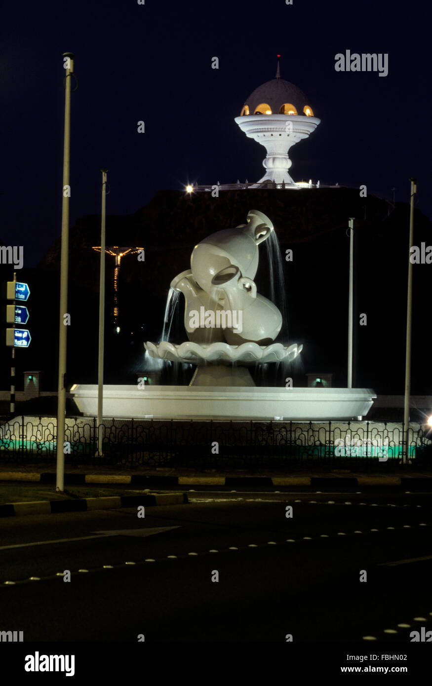 Muscat, Oman.  Monumental Incense Burner and Roundabout with Water Pot Replicas at Night. - Stock Image