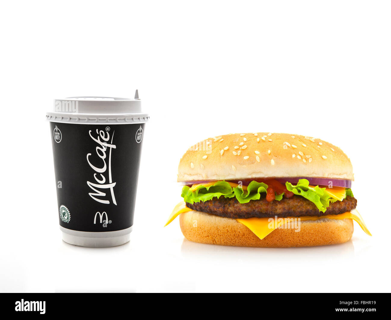 McDonalds McCafe Coffee with Cheeseburger on a white background - Stock Image