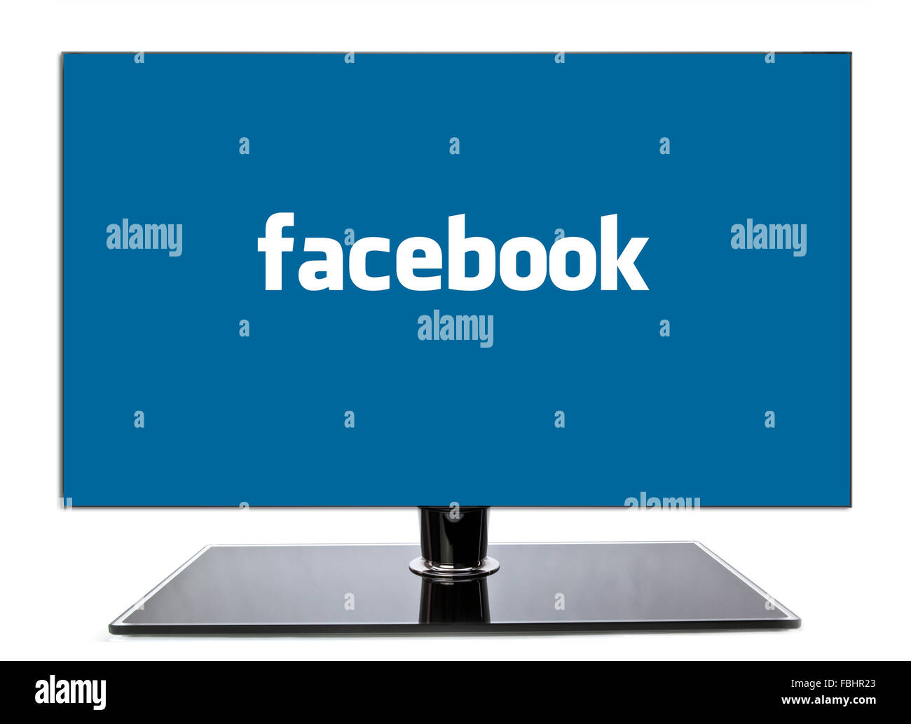 Monitor Showing Facebook page on a white background - Stock Image