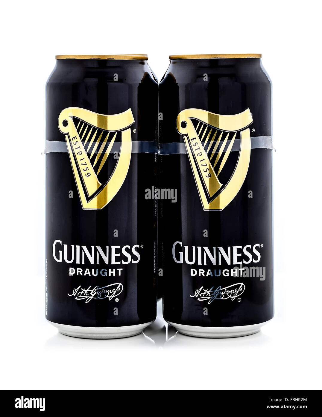 Four Pack of Guinness, the popular Irish beer on a white background - Stock Image