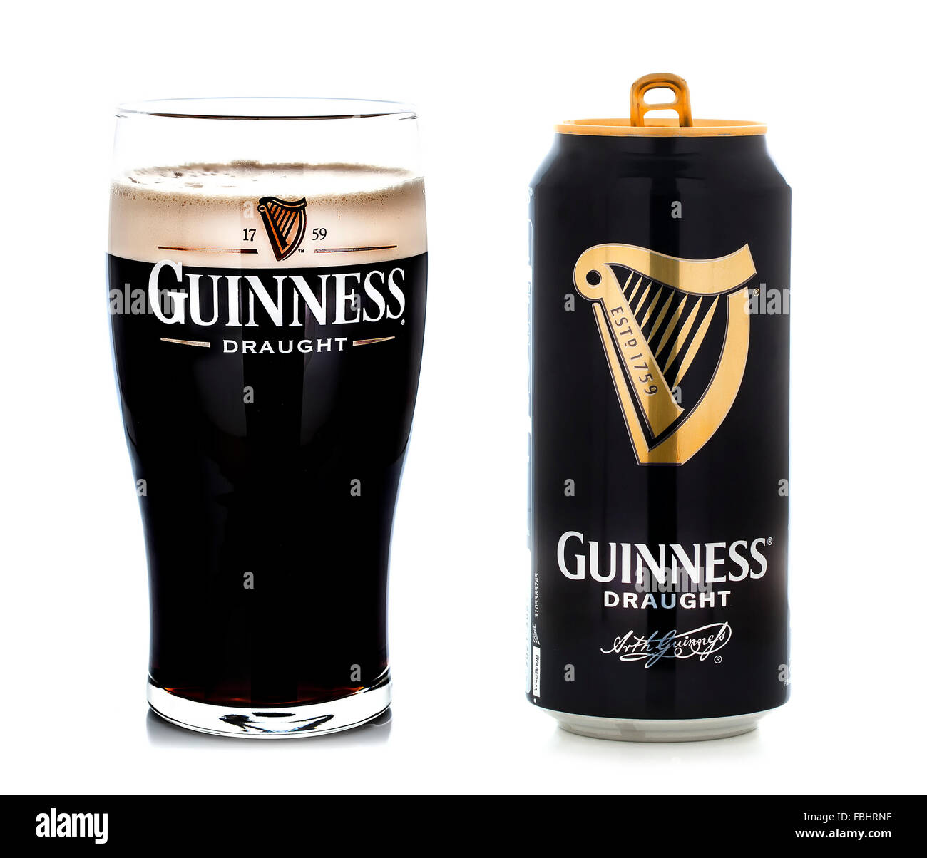 Pint of Guinness, the popular Irish beer on a white background - Stock Image