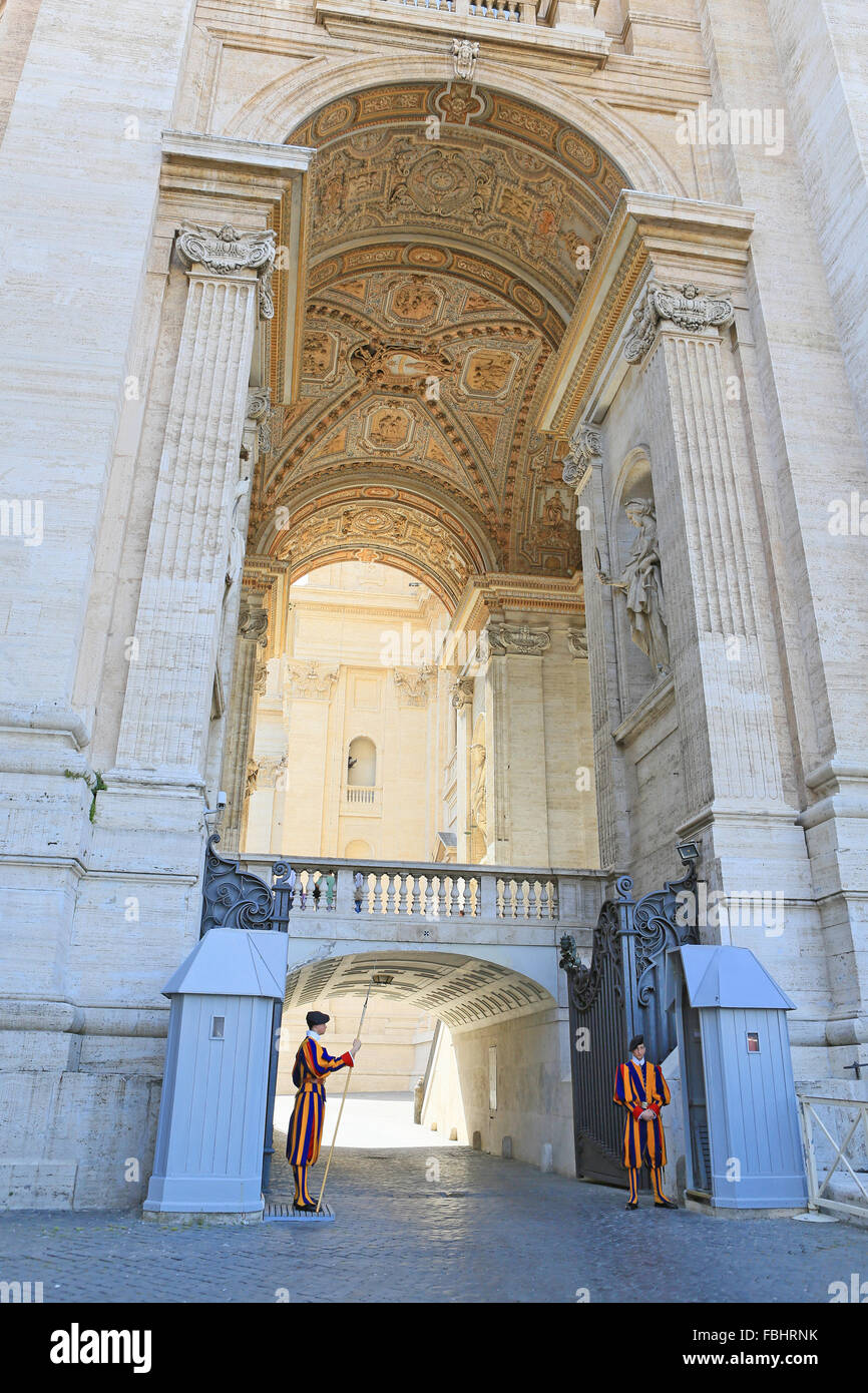 Papal Swiss guards outside St Peter's Basilica, Vatican City, Rome, Italy. - Stock Image