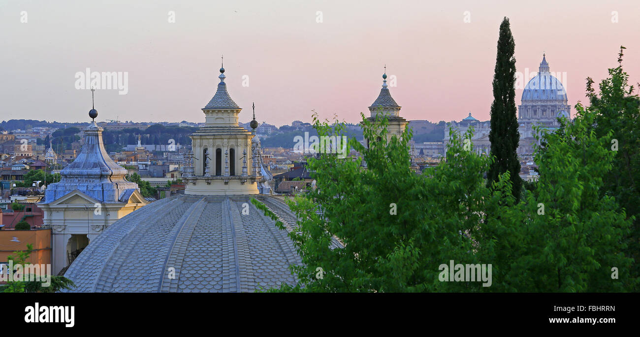 Domes of Santa Maria Churches (and St Peter's Basilica in background) at dusk, Rome, Italy. View from Pinicio - Stock Image