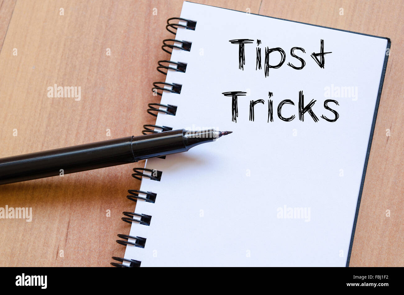 tips and tricks text concept write on notebook with pen stock photo
