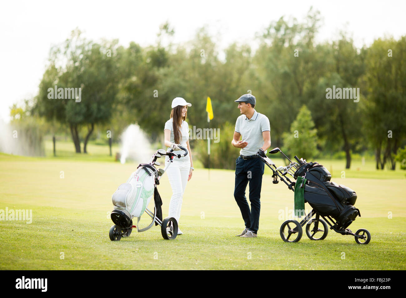Young couple at golf cart - Stock Image