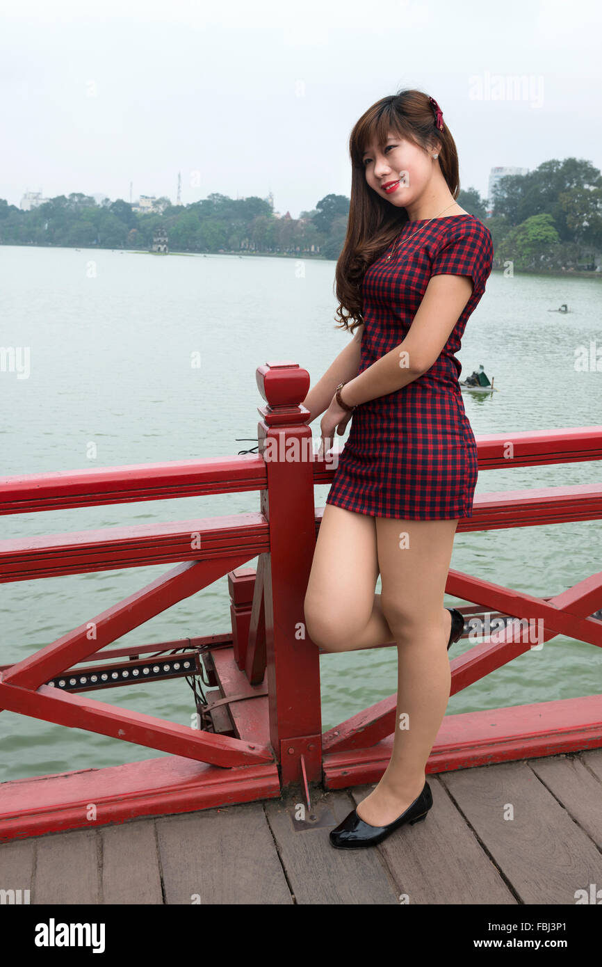 Young woman on the bridge to Quan Thanh Temple on Truc Bach Lake in Hanoi, Vietnam. - Stock Image