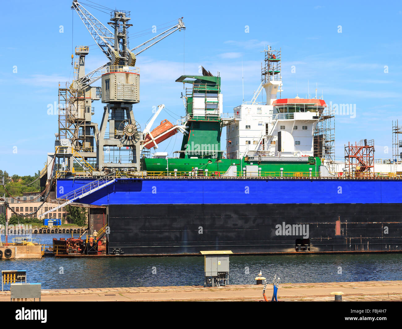 A big ship on the dry dock in a shipyard Gdynia, Poland. - Stock Image