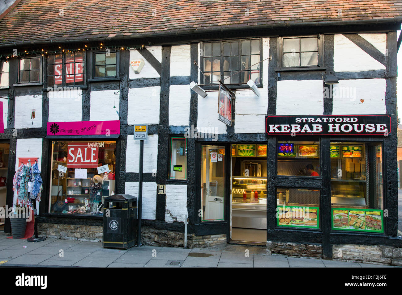 A historic Tudor building being used as a shop and Kebab House, Stratford upon Avon, Warwickshire, England, UK - Stock Image
