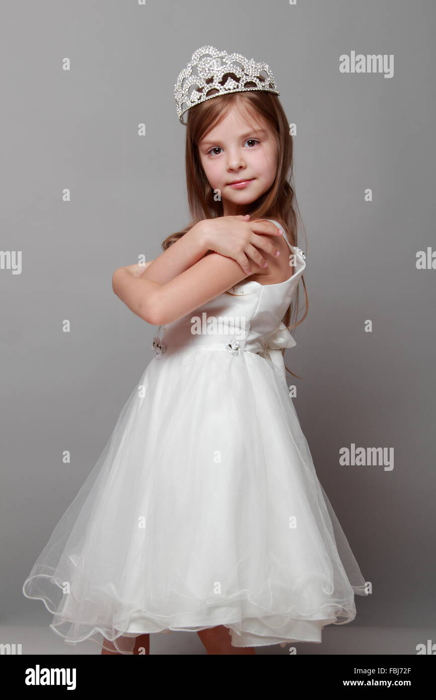 8899dd3a0e0a Beautiful little girl in princess dress with long hair on grey background