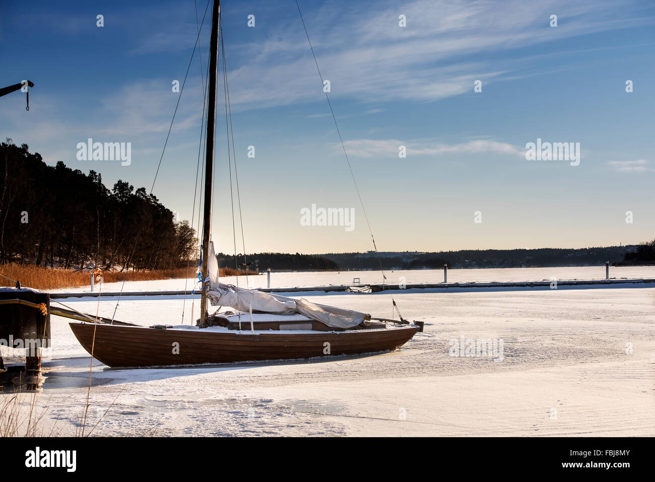 Frozen sailing boat - Stock Image