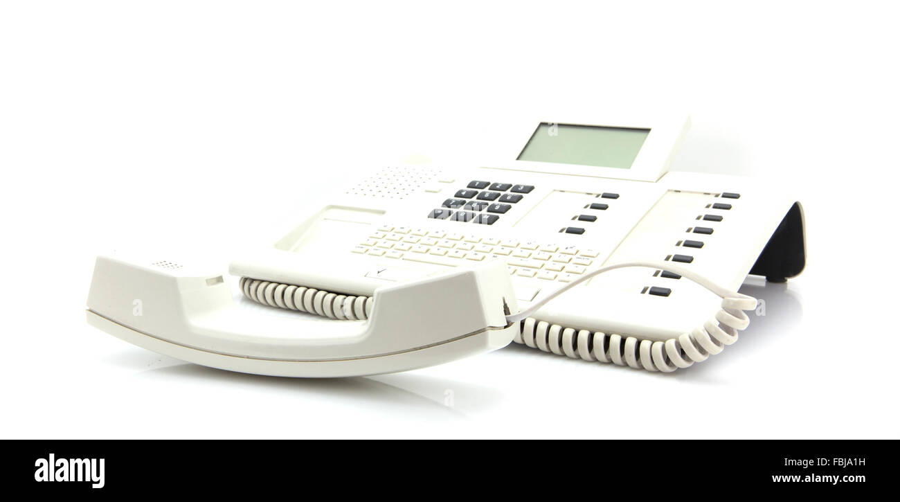 Modern White Office Phone with shallow depth of field on white background - Stock Image