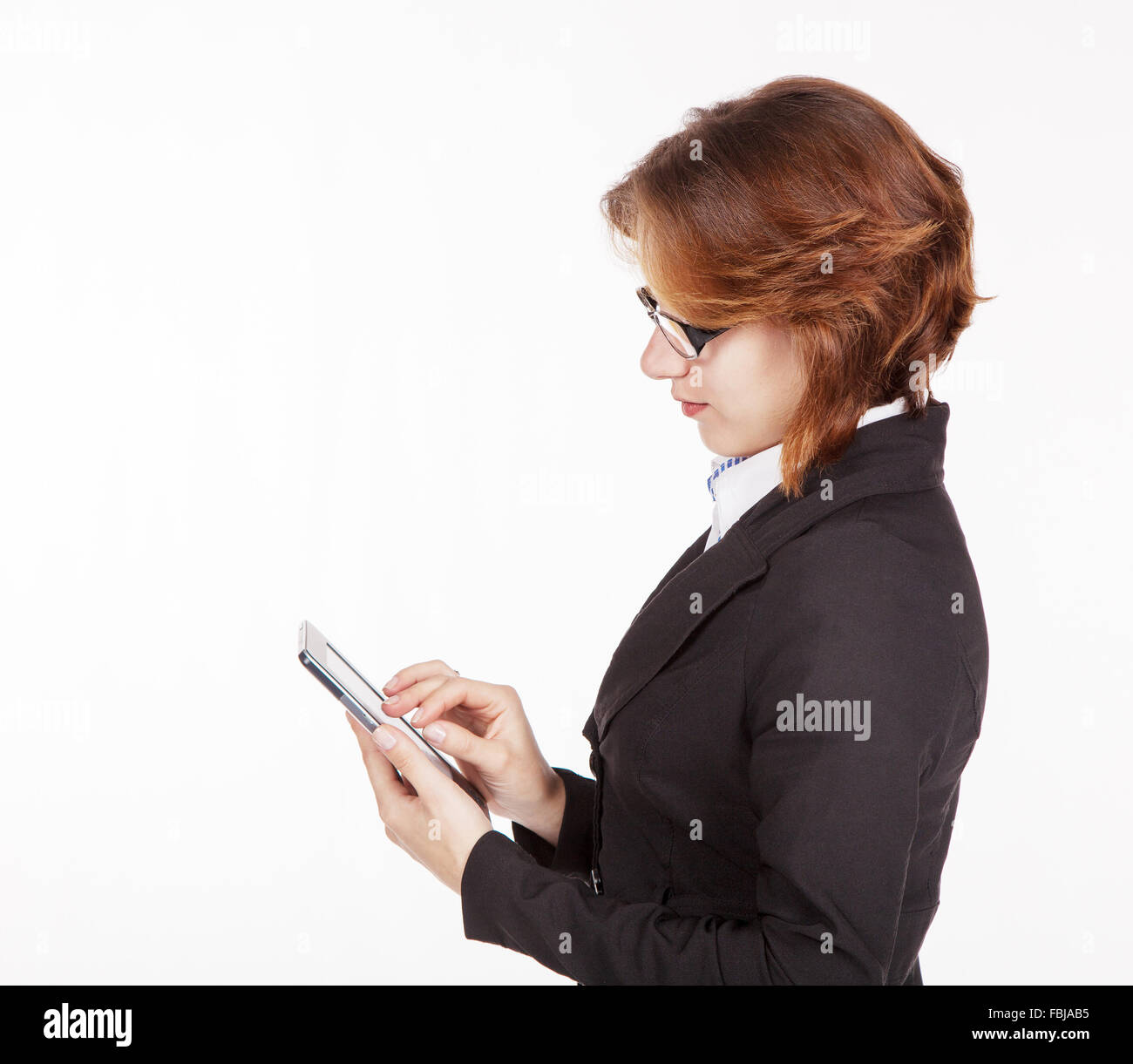 young business woman in black suit and glasses looking at the tablet display Stock Photo