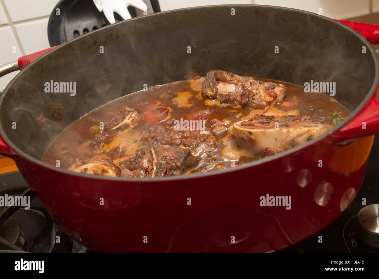 Rouladen in a roasting dish - Stock Image