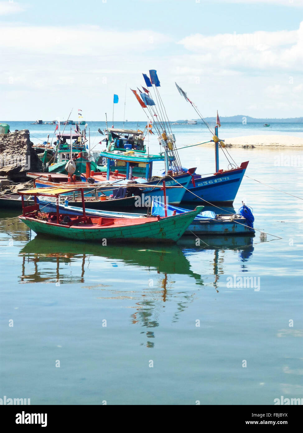 several fishing boats, reflections in the water, harbour, Phú Quoc, Vietnam Stock Photo