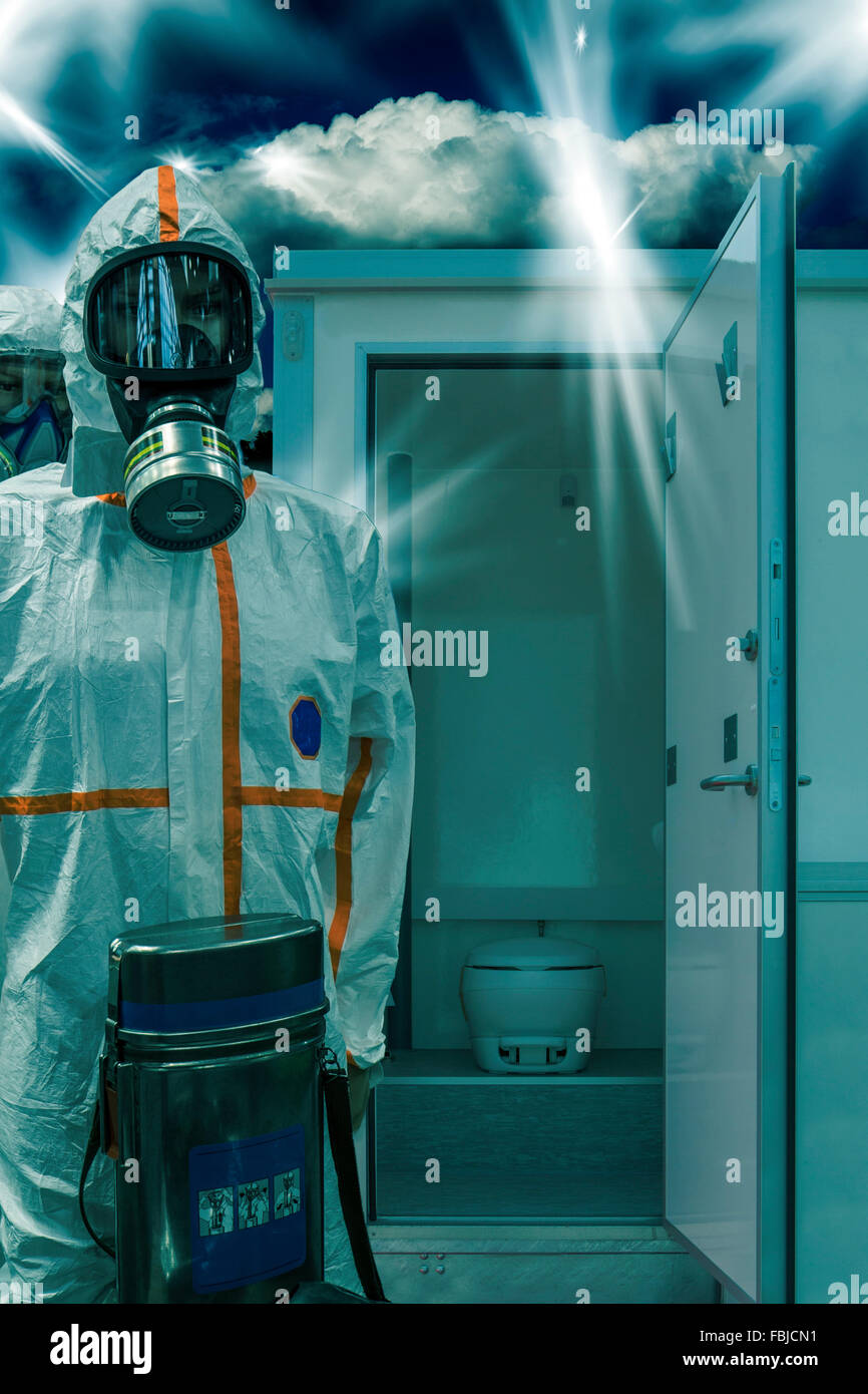Man in protective suit in front of a chemical toilet - Stock Image