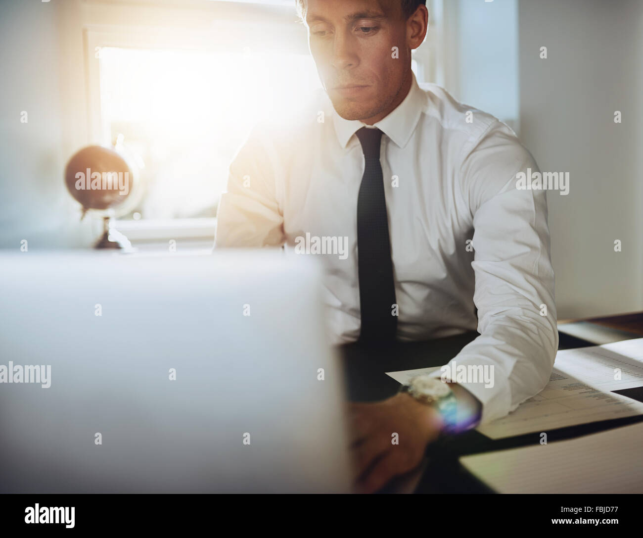 close up of executive business man with laptop working concentrated - Stock Image