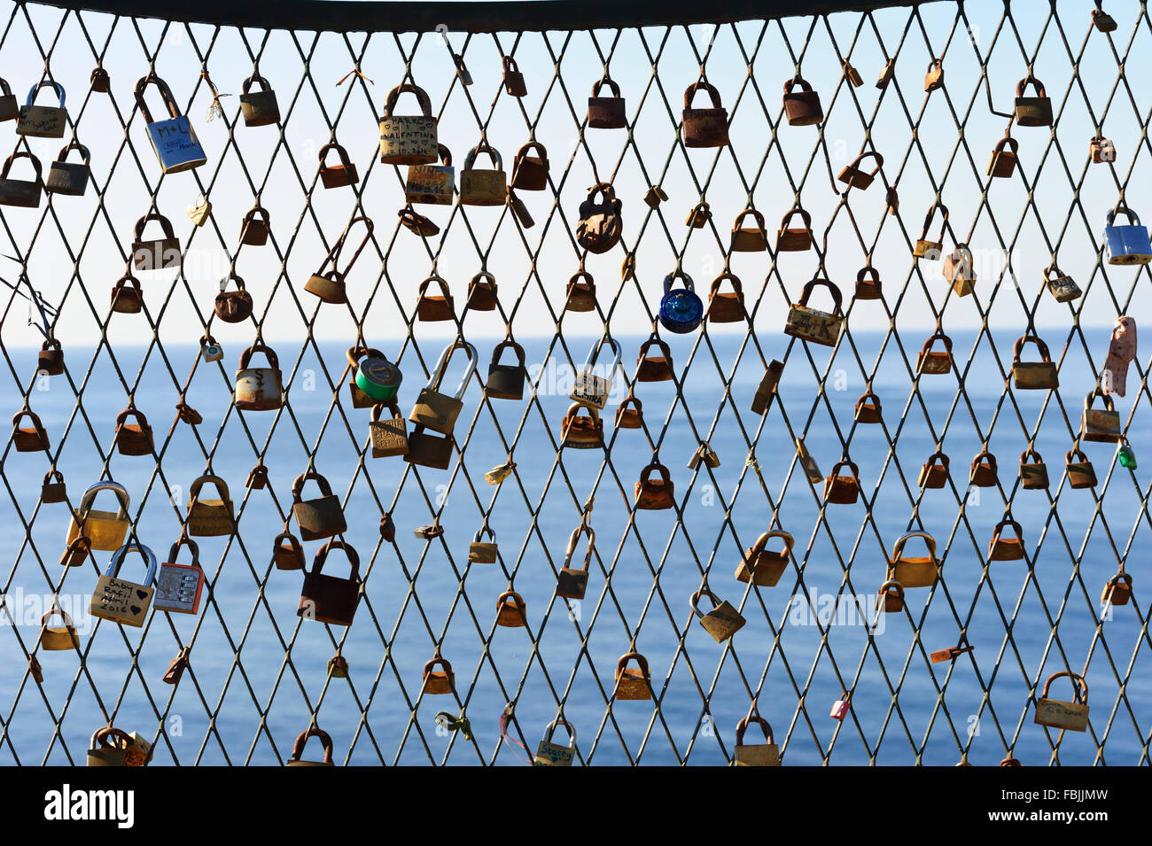 Several Padlocks On A Wire Fence A Symbol Of Affection Between