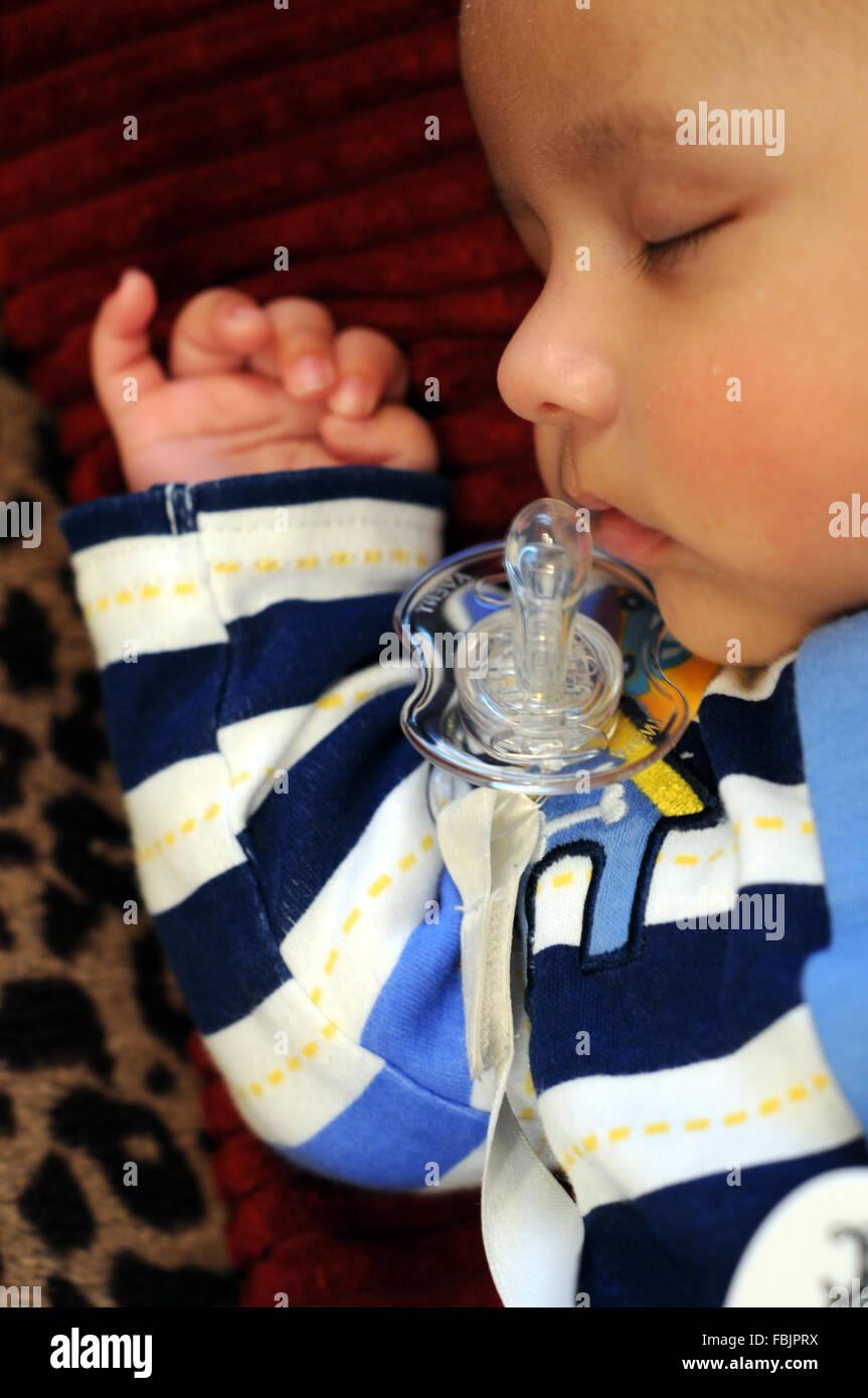 A sleeping baby. - Stock Image