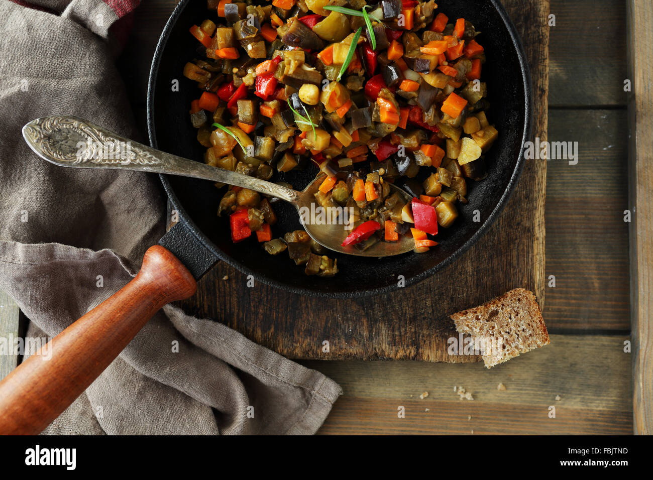 roasted vegetables pieces (tomato, aubergine, pepper), top view Stock Photo