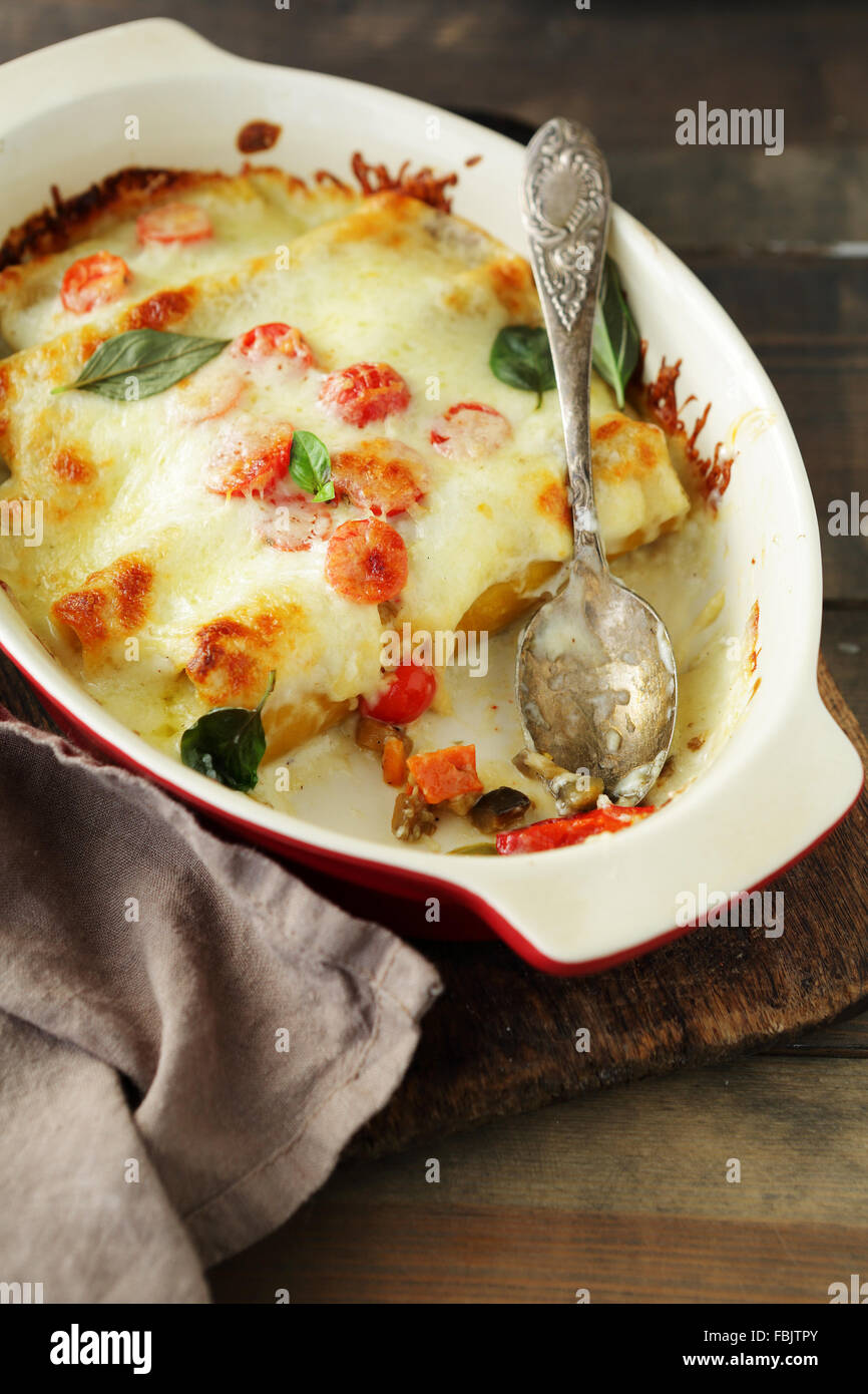 baked cannelloni with cheese, italian food - Stock Image
