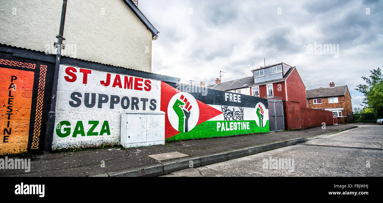 St James area of West Belfast supports Gaza against Israel with Free Palestine slogan mural. - Stock Image