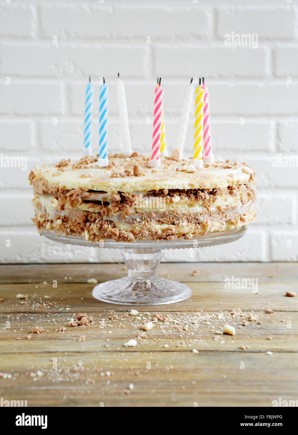 birthday candles on rustic cake, food close-up - Stock Image