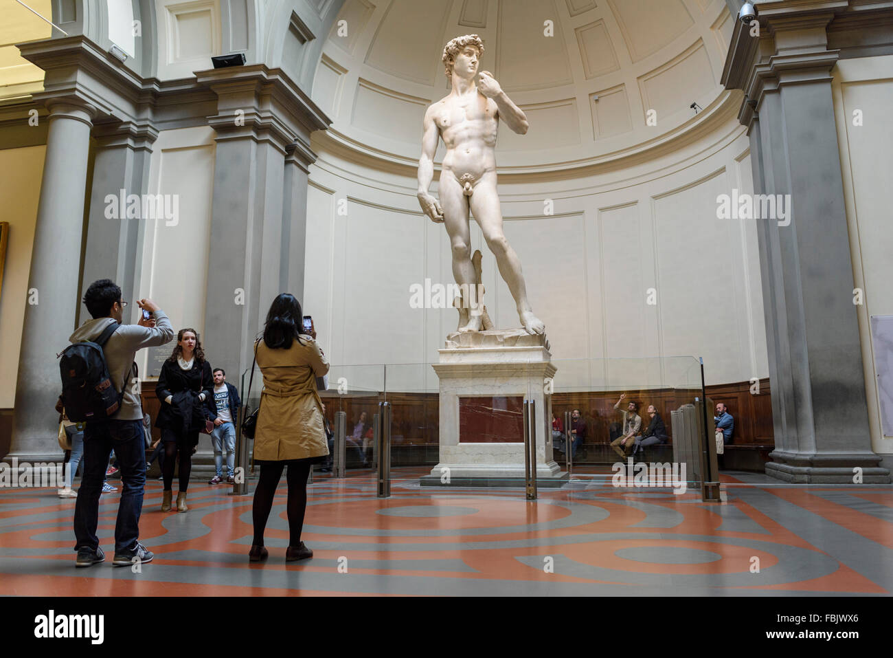 Florence. Italy. Tourists visit Michelangelo's statue of David at the Galleria dell'Accademia museum. Gallery - Stock Image