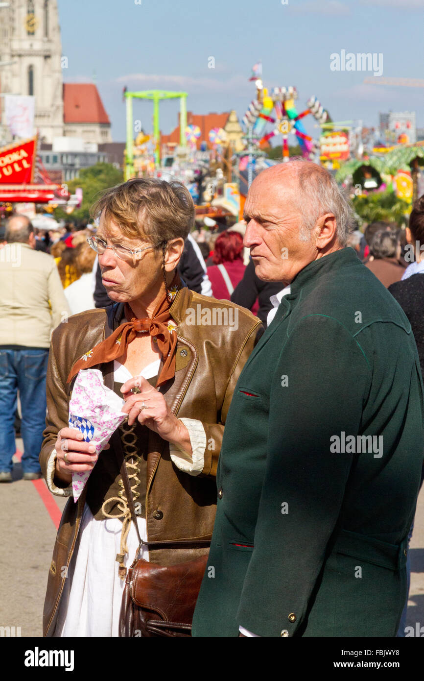 Older couple with serious faces at Oktoberfest in Munich, Germany - Stock Image