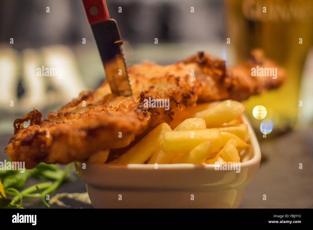 Traditional Irish Fish and chips served in an Irish pub in Dublin City Centre. - Stock Image
