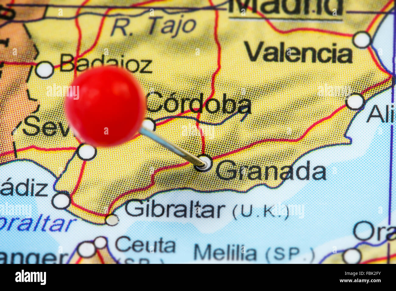 Map Of Spain Granada.Close Up Of A Red Pushpin In A Map Of Granada Spain Stock Photo