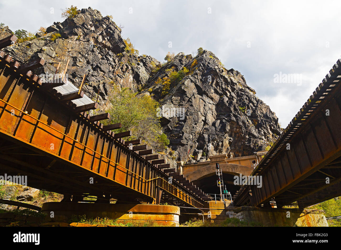 Harpers Ferry train tunnel and bridge across Shenandoah River in West Virginia, USA. Stock Photo