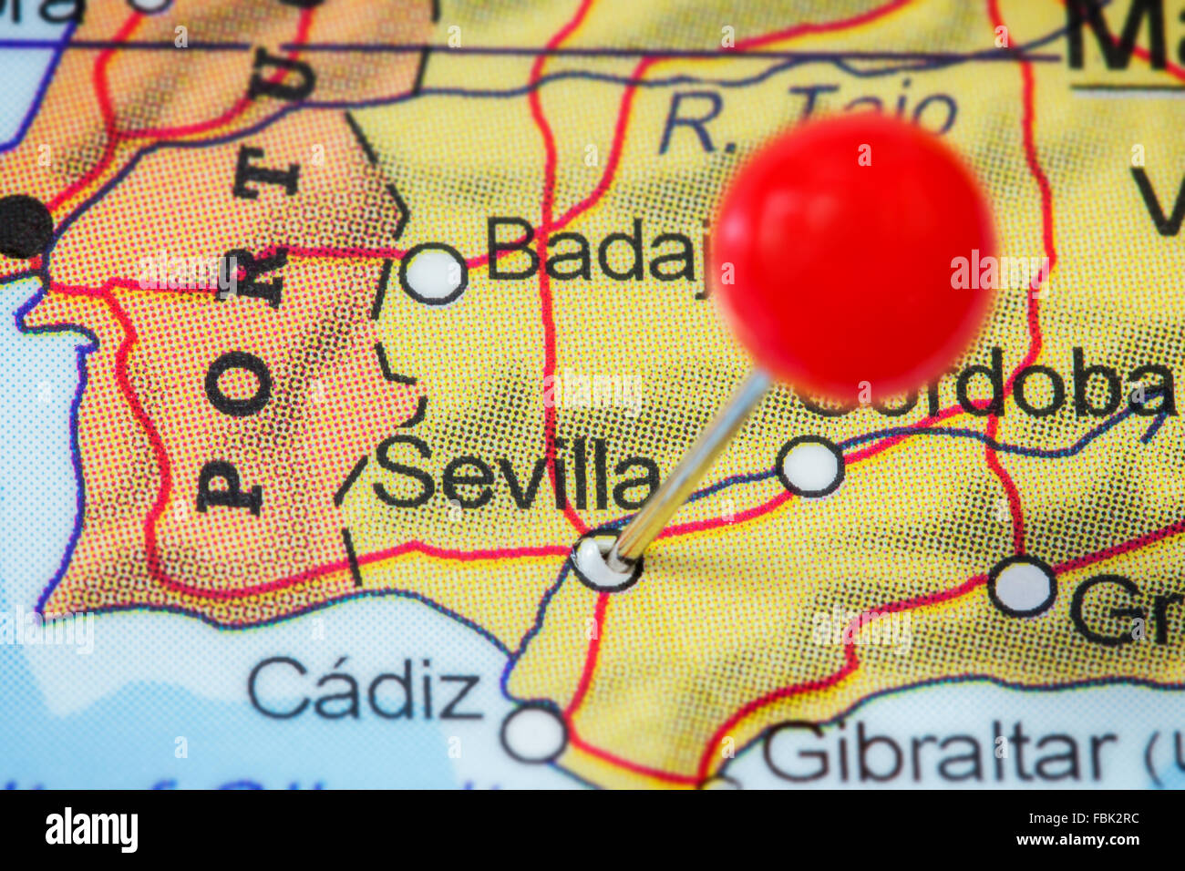 Close Up Of A Red Pushpin In A Map Of Sevilla Spain Stock Photo