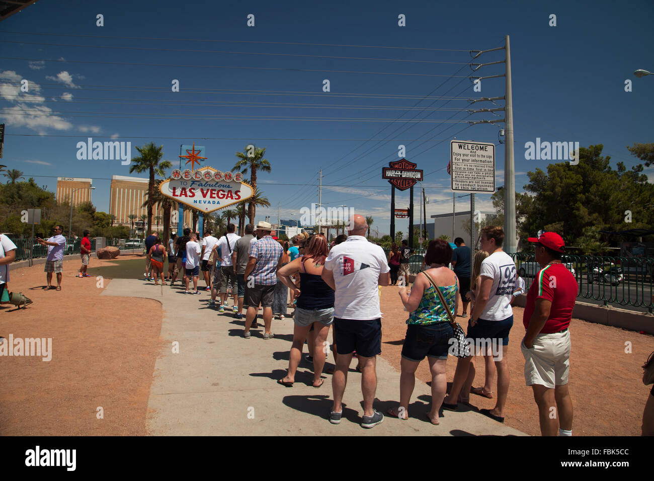 Queue of tourists waiting to take their pictures at the 'Welcome to Las Vegas' Sign. - Stock Image