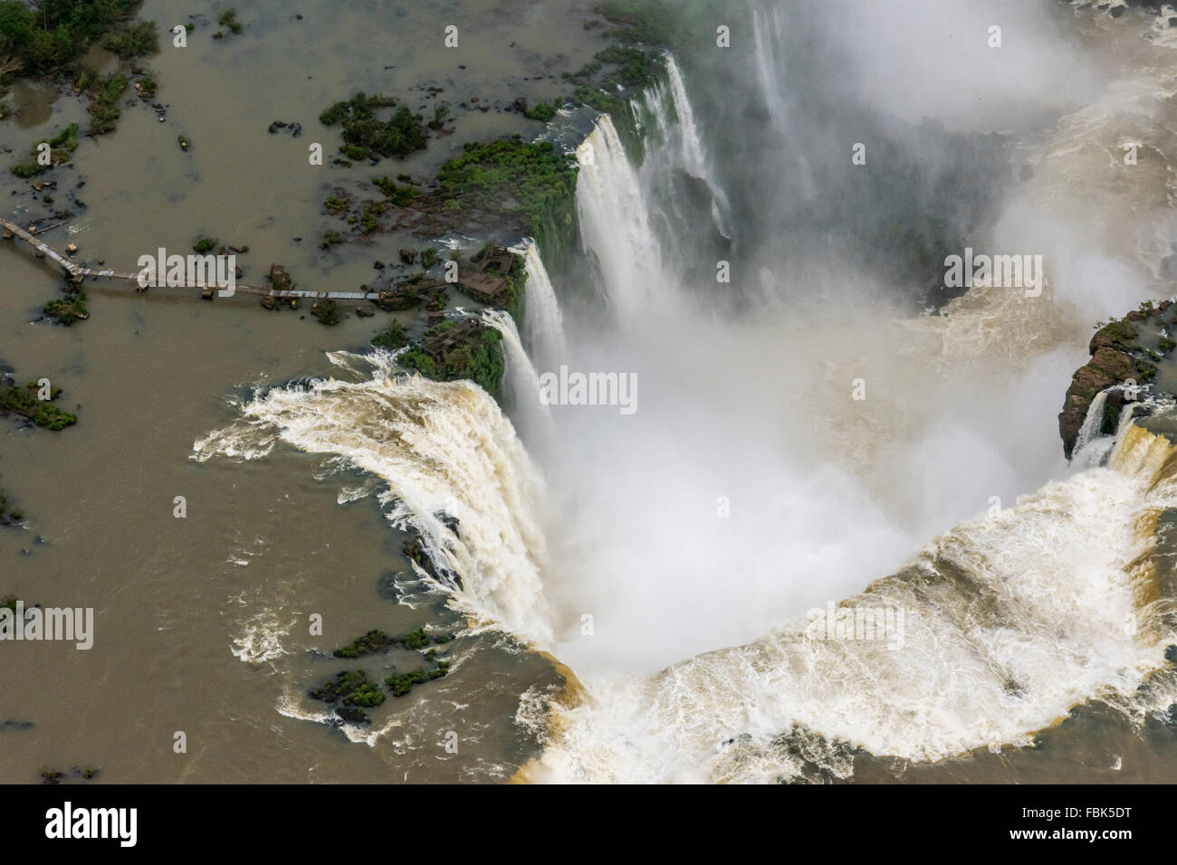 Directly over the Devil's Throat with the wreck of the walkway, Argentinian side, Foz do Iguacu, Brazil Argentina - Stock Image