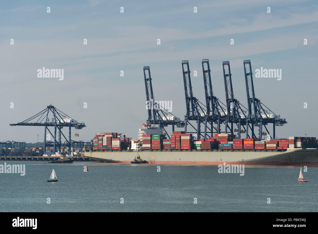 A container ship docked at the Port of Felixstowe in England, UK. - Stock Image