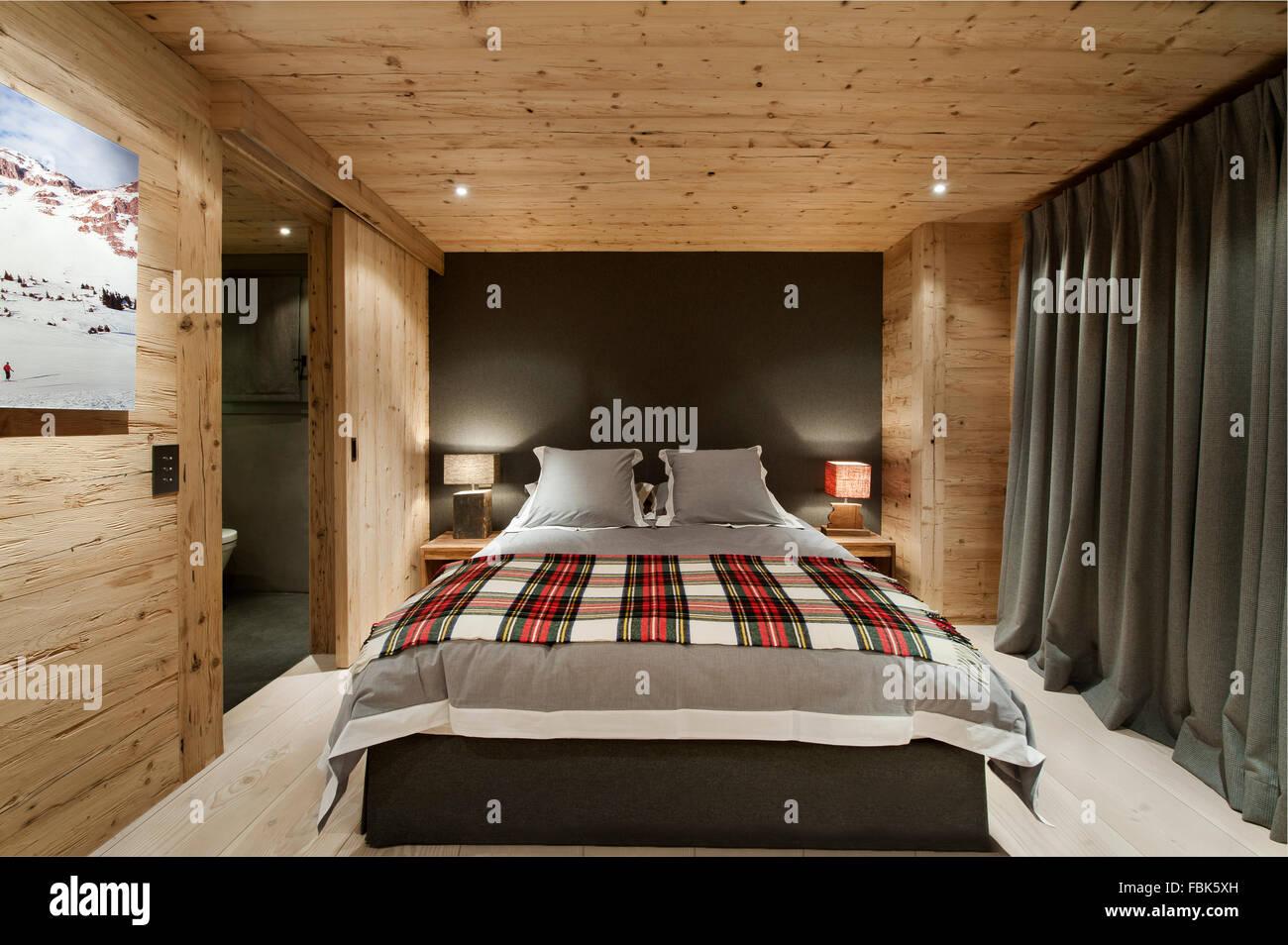 Chalet Gstaad; bedroom; interiors - Stock Image