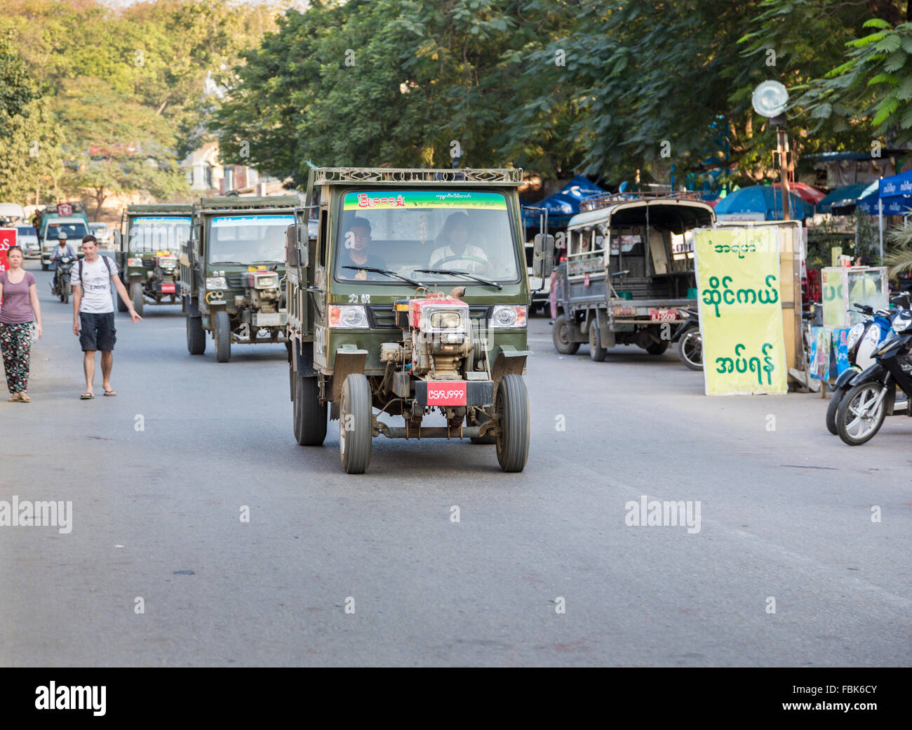 Typical open-fronted Chinese made trucks with air-cooled engine on the street in Mandalay, Myanmar (Burma) - Stock Image