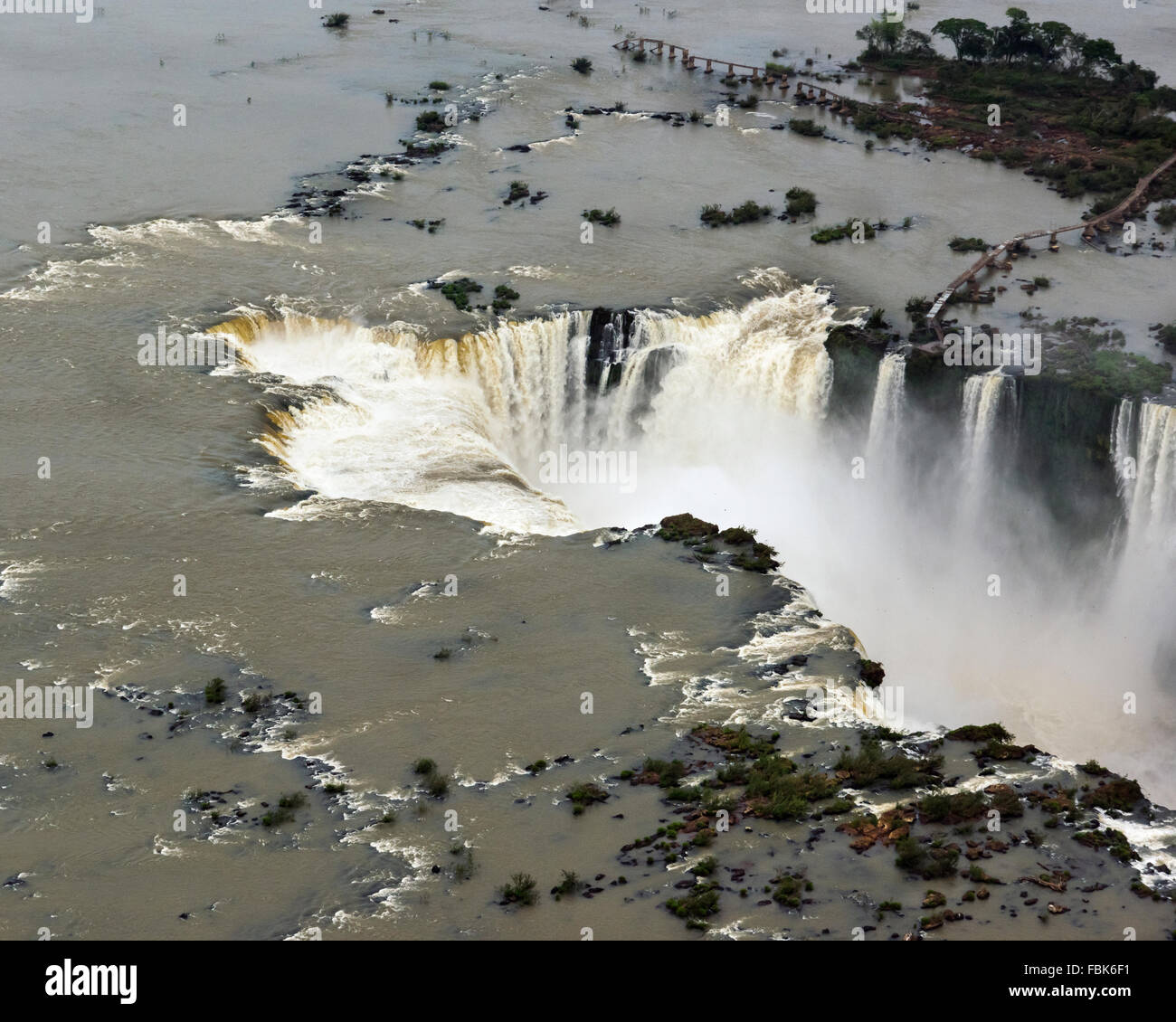Aerial view, Garganta do Diablo (Devil's Throat) with small birds and ruined walkway, Foz do Iguacu, Brazil - Stock Image