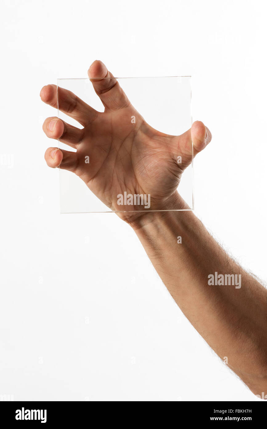 Man displaying a square of clear transparent glass in one hand - Stock Image