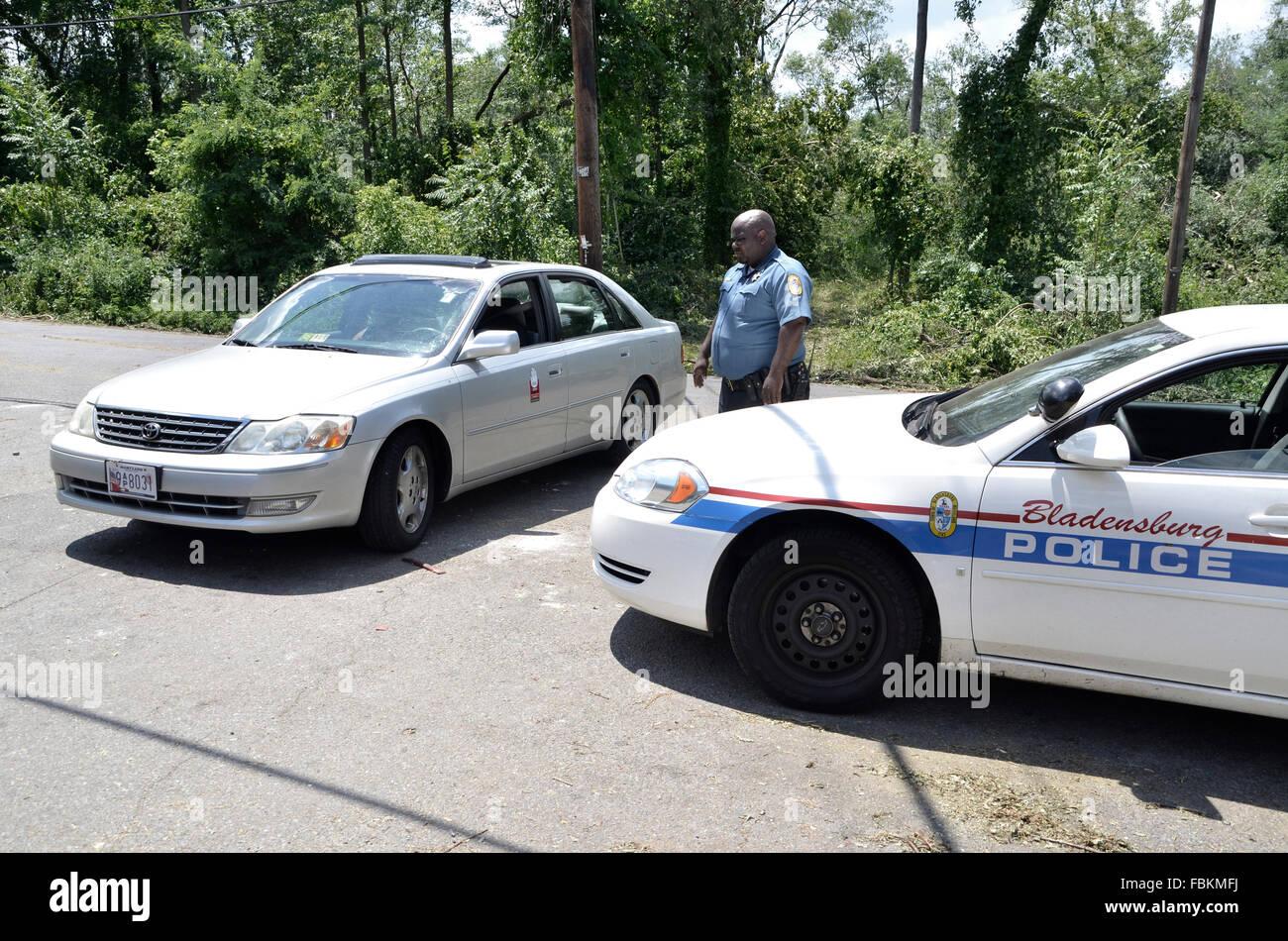 Police officer mans a roadblock in Bladensburg, Maryland - Stock Image