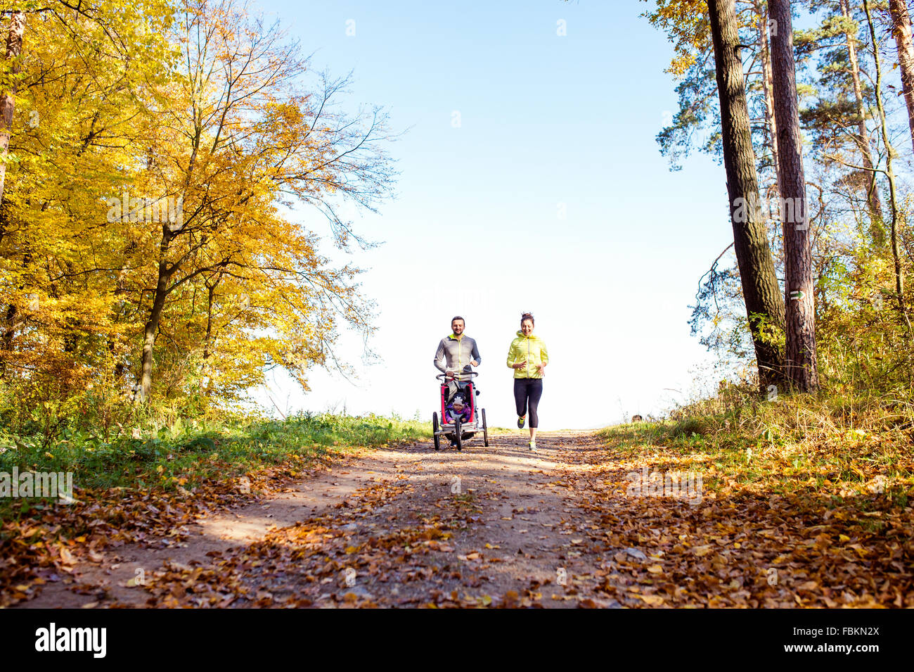Young family running - Stock Image