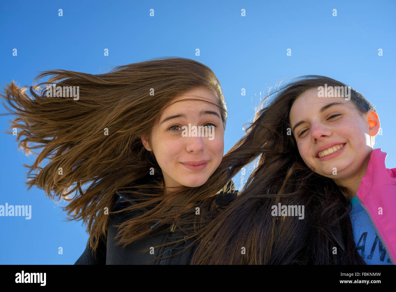 Young teens taking a selfie on a windy beach Cape May New Jersey. - Stock Image