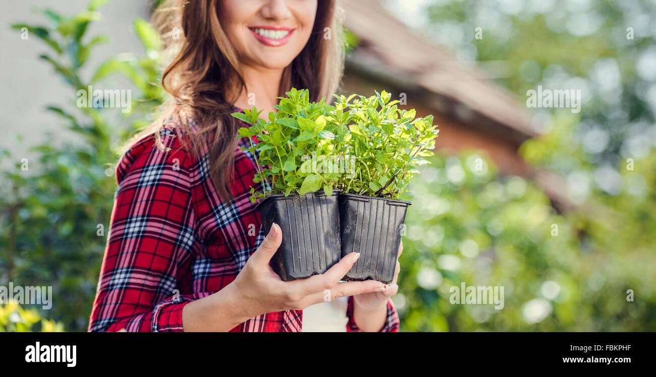 Beautiful young woman gardening - Stock Image