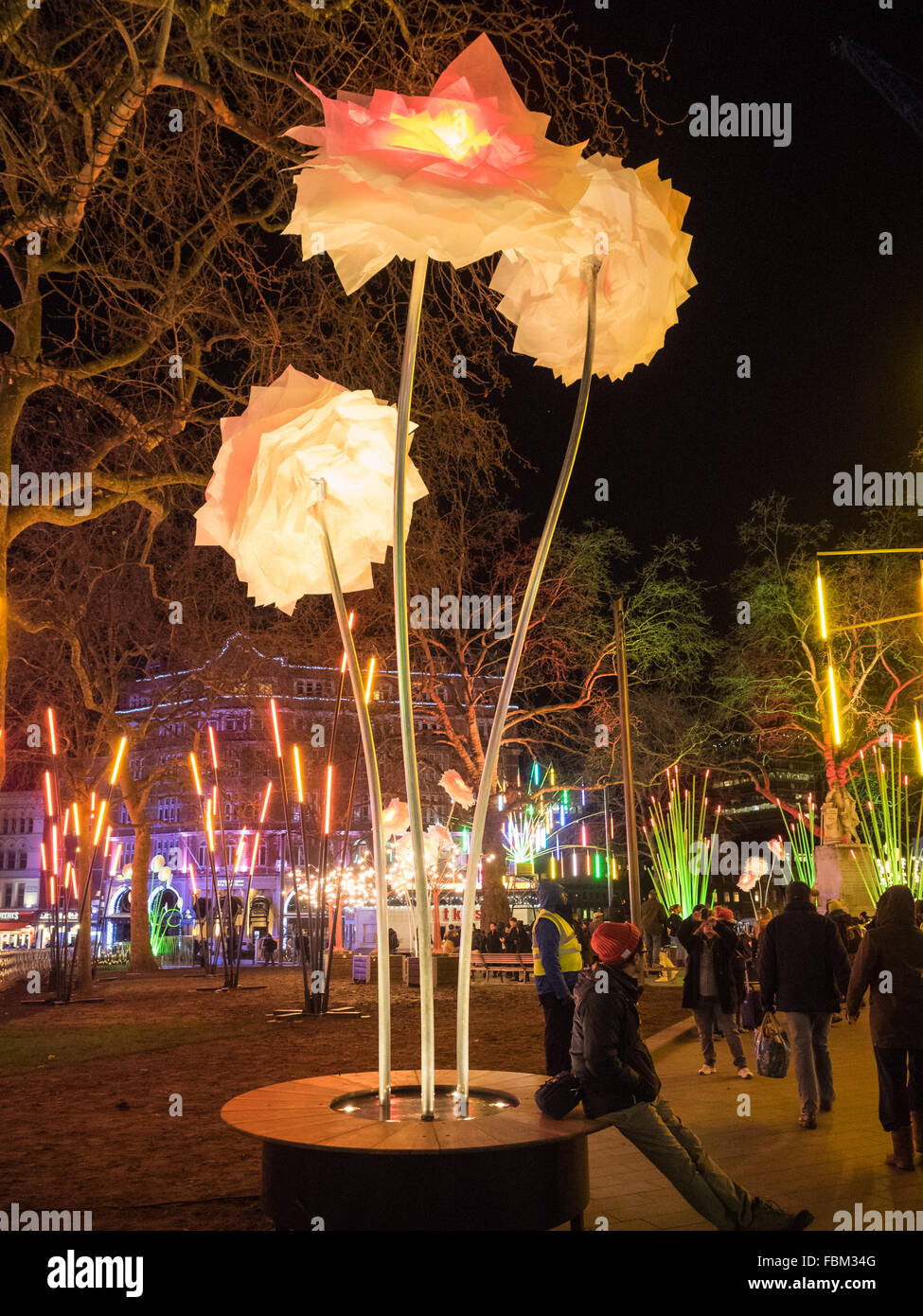 a London Lumiere flower light exhibit in Leicester Square gardens at night UK - Stock Image